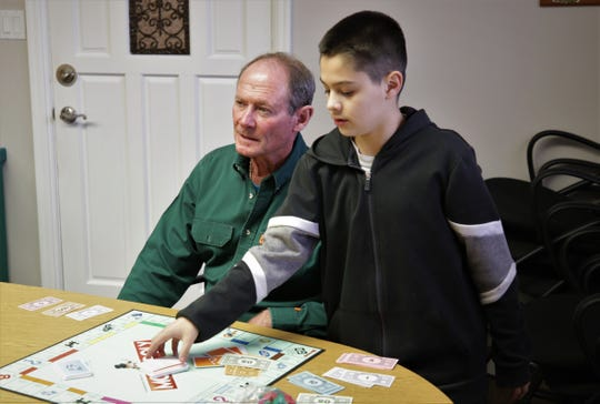 Dave Beavers, left, and Gabriel Gonzales spend much of their time together in the Big Brothers Big Sisters of San Juan County's mentoring program playing games, seeing movies, riding mountain bikes and watching baseball.