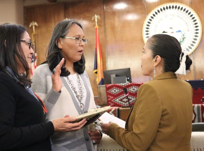 Tina Tsinigine, second from left, takes the oath of office for the Navajo Nation Supreme Court on Jan. 28 in Window Rock, Arizona. The Navajo Nation Council confirmed Tsinigine to the high court during the winter session.
