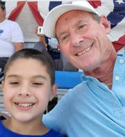Gabriel Gonzales, left, and Dave Beavers, who are a match in the Big Brothers Big Sisters of San Juan County mentoring program, are pictured at a Connie Mack World Series Game in August 2019.