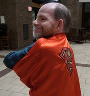 Jimmy Crowley said he'll sometimes wear this Superman cape to remind his elderly friends who he is as he tends to their lawns and shovels their snow for free.