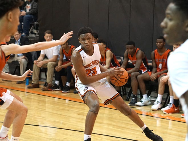 Brother Rice Warrior Curtis Williams takes a pass near the edge of the three point line during a game early this year. The upcoming sophomore already received his first Division I scholarship offer.