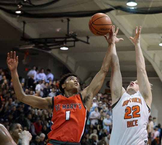 Brother Rice's Luke Newman, right, goes up for  rebound along with Orchard Lake St. Mary's Julian Roper II.