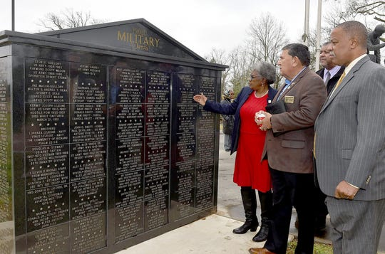 A wall of honor, the newest addition to the St. Landry Parish Veterans Memorial,  was part of the tour conducted by Pat Mason-Guillory Wednesday with special guests pictured, from left, Patricia Mason-Guillory, Retired Col. Joey Strickland, Opelousas Mayor Julius Alsandor and Sen. Gerald Boudreaux. Strickland serves as Secretary of the Louisiana Department of Veterans Affairs.