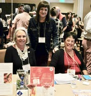 Members of Les Dames d'Escoffier Palm Springs Nancy Edney, Lori Ferro and Nancy Cohee are at the ready to process silent auction bids. Auction proceeds benefit the nonprofit's scholarship fund.
