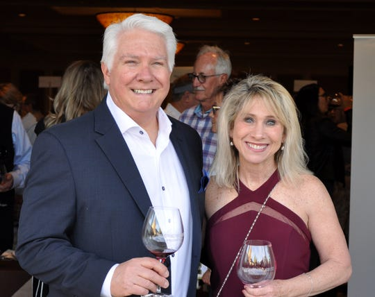 Event producer David Fraschetti and his wife, Lynn, take a moment to enjoy their own wine tasting.