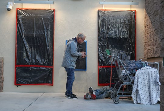 Dave Boughner interviews a man sleeping outside of a Cathedral City business during a count of the city's homeless, January 29, 2020.