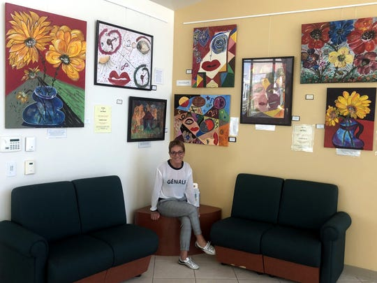 Jean Vezzalini shows off her artwork, which will be showcased in the Indian Wells Theater at the Cal State San Bernardino, Palm Desert Campus, with all proceeds going to student scholarships.