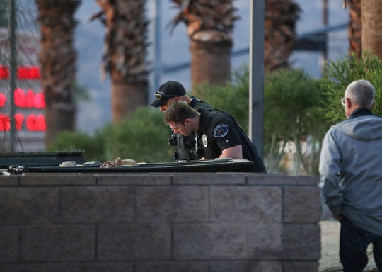 Cathedral City police officers Matt Buehler and Joe Brooks find two homeless people inside the walls of the trash bin holding area while the two were involved in the annual point-in-time survey of the city's homeless, January 29, 2020.