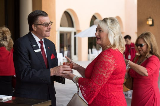 Tom Scaramellino greets a guest at the 2019 Go Red for Women event.
