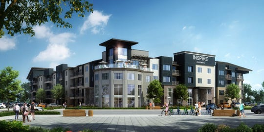 An architect's rendering shows the front of the proposed 350-unit Inspire building, part of a large development on West Nine Mile Road.