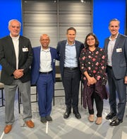Jocelyn Desbiens (left), senior data scientist at IRIS, Dr. Sunil Gupta, founder of IRIS, John Kahan, chief data analytics officer at Microsoft, Anusua Trivedi, senior data scientist at Microsoft, and Steve Martin, IRIS CEO, pose for a photo on Wednesday, Jan. 29, 2020. IRIS was selected by Microsoft as one of the AI for Health grant winners.