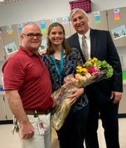 Oriole Beach Elementary Principal Josh McGrew, Santa Rosa County Teacher of the Year Elizabeth Mann and Superintendent Tim Wyrosdick pose for a photo Wednesday after the news was announced.