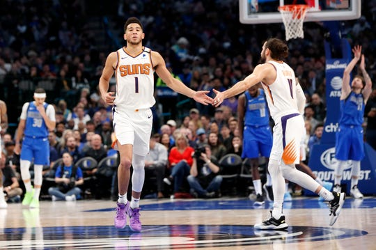 Jan 28, 2020; Dallas, Texas, USA;  Phoenix Suns guard Devin Booker (1) and  guard Ricky Rubio (11) celebrate during the third quarter against the Dallas Mavericks at American Airlines Center. Mandatory Credit: Kevin Jairaj-USA TODAY Sports