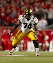 Iowa Hawkeyes offensive lineman Tristan Wirfs (74) is a trendy pick for the Arizona Cardinals in NFL mock drafts for the 2020 NFL draft.