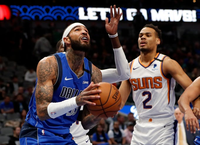 Jan 28, 2020; Dallas, Texas, USA;  Dallas Mavericks center Willie Cauley-Stein (33) shoots as Phoenix Suns forward Elie Okobo (2) defends during the fourth quarter at American Airlines Center. Mandatory Credit: Kevin Jairaj-USA TODAY Sports