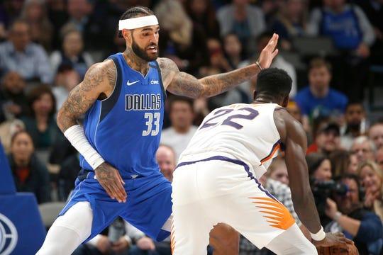 Dallas Mavericks center Willie Cauley-Stein (33) defends against Phoenix Suns center Deandre Ayton (22) during the second half of an NBA basketball game Tuesday, Jan. 28, 2020, in Dallas. Phoenix won 133-104. (AP Photo/Ron Jenkins)