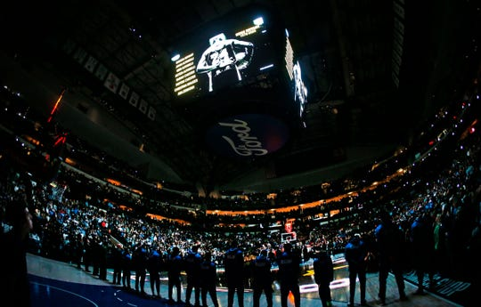 An image of Kobe Bryant is displayed above the American Airlines Center during a moment of silence before an NBA basketball game between the Phoenix Suns and the Dallas Mavericks Tuesday, Jan. 28, 2020, in Dallas. Bryant and his daughter were among nine people killed Sunday in a California helicopter crash. (AP Photo/Ron Jenkins)