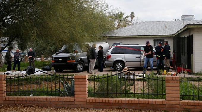 Phoenix Police Department and Fire Department investigators on Jan. 29, 2020, work at a Phoenix home where skeletal remains were found. The remains were found at a house where authorities previously removed at least one child as part of a child abuse investigation in which both parents of that child were in custody, police said.