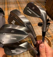 PGA Tour pro Justin Thomas shows off his new Titleist wedges with special Kobe Bryant reminders stamped on the back.