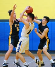 Elco's Ben Horst (5) and Bryce Coletti (4) pressure NL's Josh Clemmer (20) during the third quarter of action.