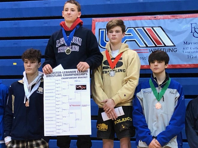 Lebanon's Griffin Gonzalez, second from left, added to an already spectacular freshman season last Saturday when he became the Cedars' first league champion in over a decade by capturing the 120-pound title at the Lancaster-Lebanon League Championships.