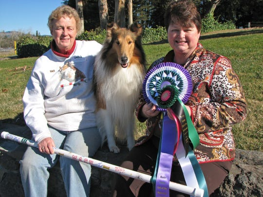 Jif, a collie owned by Sue Larson, left, receives  her MACH (Masters agility championship) title from judge and LaGrangeville resident, Lavonda L. Herring.