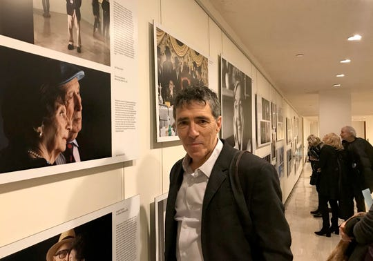 Journal News photojournalist Seth Harrison stands beside his portrait of  Holocaust survivors Ellen and Jerry Kaidanow, who now live in New Rochelle. The portrait is part of the Lonka Project, now on display at The United Nations.