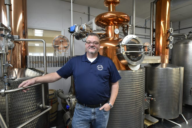 George Simmers appears with his distillation system, from Hungary-based Hagyo Spirits. He said the equipment is top-of-the-line, and two engineers from the company had to come install it.