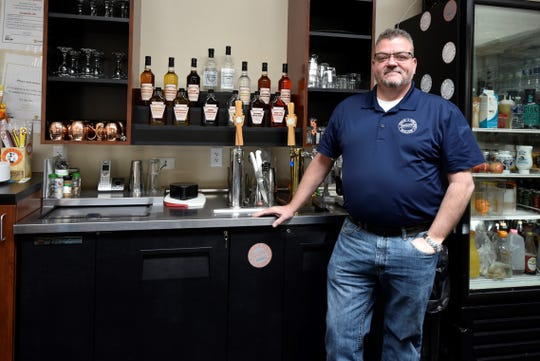 George Simmers stands behind the bar in the tasting room at Cold Spring Hollow Distillery in Mercersburg, which he co-owns with three others. The company's products can be seen in the background, including their flavored vodkas (apple dumpling, butterscotch, cherry, citron splash, rootbeer and sweet fire).