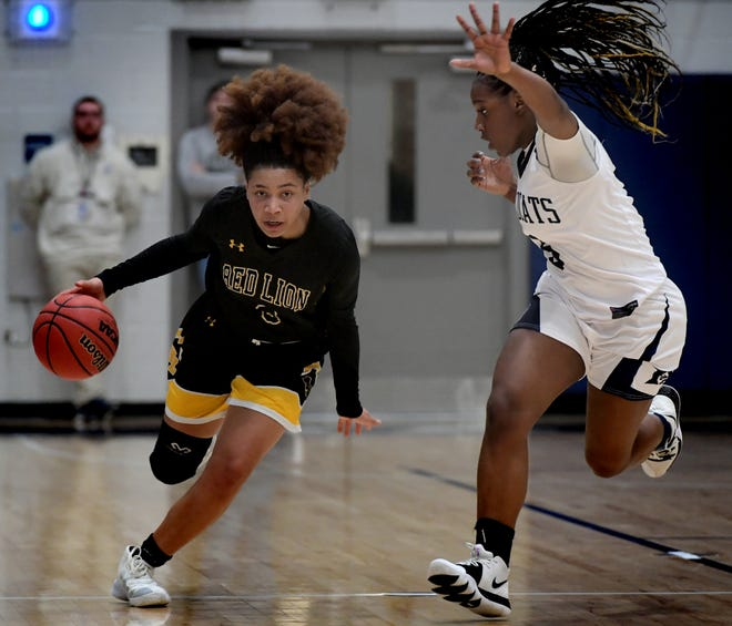 Red Lion's Asia Eames moves the ball against Dallastown's D'shantae Edwards during basketball action at Dallastown Tuesday, January 28, 2020. Bill Kalina photo