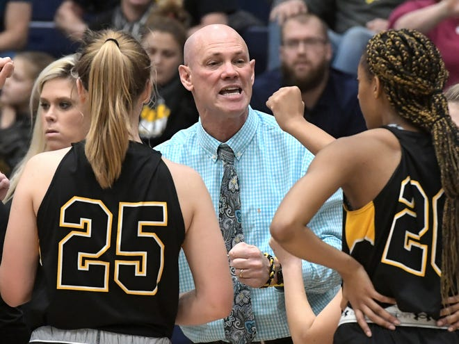 Red Lion coach Don Dimoff talks to his team in a timeout during a game at Dallastown on Tuesday, Jan. 28. The Lions and Wildcats will meet in the York-Adams semifinals at 6 p.m. Wednesday at Dallastown. Bill Kalina photo