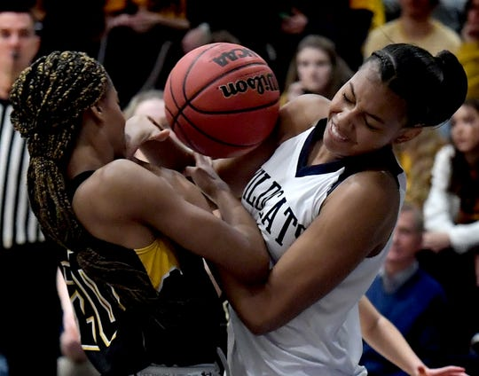 Dallastown's Aniya Matthews and Red Lion's Makiah Shaw, left, battle for possession during basketball action at Dallastown Tuesday, January 28, 2020. Bill Kalina photo