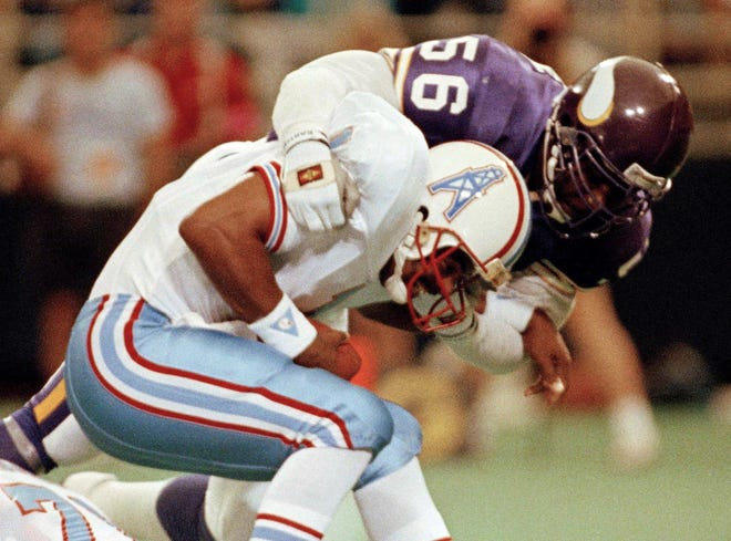 FILE - In this Aug. 27, 1990, file photo, Minnesota Vikings linebacker Chris Doleman (56) brings down Houston Oilers quarterback Warren Moon for a safety during preseason NFL football action in Minneapolis. Hall of Fame defensive end Doleman, who became one of the NFL's most feared pass rushers during 15 seasons in the league, has died. He was 58. The Vikings and Pro Football Hall of Fame president and CEO David Baker offered their condolences in separate statements late Tuesday night, Jan. 29, 2020. (AP Photo/Jim Mone, File)