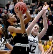 Red Lion's Makiah Shaw, seen here in a photo at right, scored 20 points on Monday night in a win vs. Warwick.