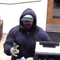 The FBI describes the robber as a male, light complexion, about 25 to 35 years old and 5 feet 10 inches to 6 feet tall, stocky to muscular build. At the time of the robberies, he had a closely-cropped beard and mustache.
