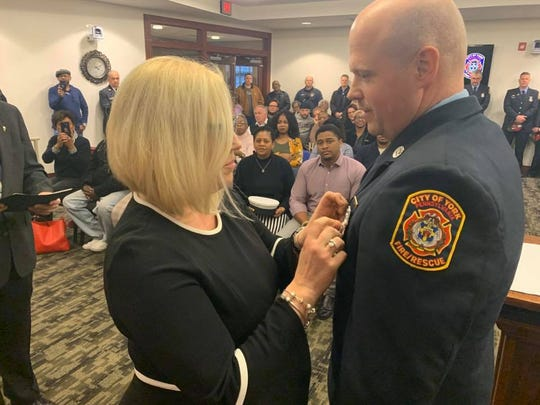 York City Fire Department's Kenneth E. Swartz II was sworn in as captain Tuesday at a ceremony held at York City Hall. Swartz's wife, Krista Swartz, pins her husband's badge.