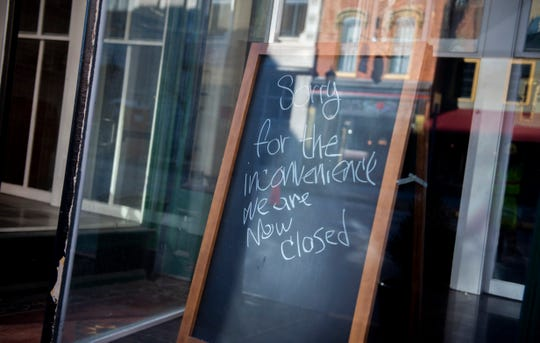 A closed sign sits in the right side of the storefront outside of DiCarlo's Pizza in downtown York on Wednesday, Jan. 29, 2020. Jodi and Ned Bauhof opened the restaurant in 2013. In 2018, the Bauhofs sold the pizzeria to David DiCarlo, who reopened the space in December 2018.