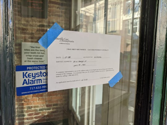 A notice from Columbia Gas is posted on the front door of DiCarlo's Pizza in downtown York on Wednesday, Jan. 29, 2020.