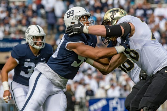 Penn State defensive end Yetur Gross-Matos rushes the passer against Purdue offensive lineman Grant Hermanns.