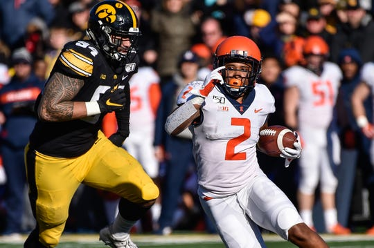 Iowa edge rusher A.J. Epenesa tried to track down Illinois running back Reggie Corbin.