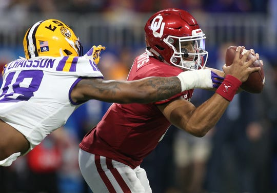 Oklahoma quarterback Jalen Hurts can't escape LSU edge rusher K'Lavon Chaisson.