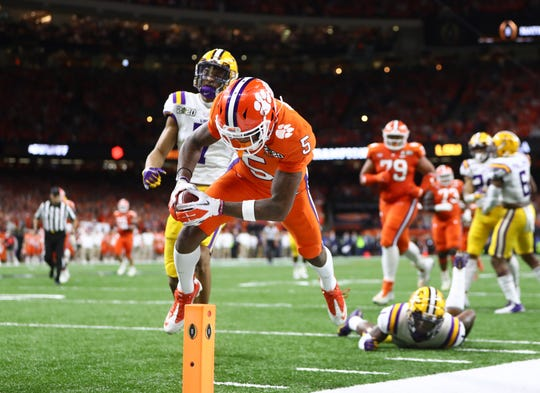 Clemson wide receiver Tee Higgins scores a touchdown against the LSU in the national championship game.