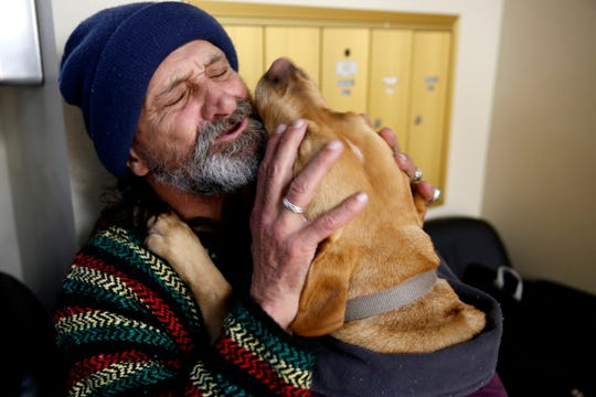 Constancio Barquero, 61, gets kisses from Lucy, his 7-year-old yellow Labrador, during the Point-in-Time count at ARCHES in downtown Salem on Jan. 29, 2020. The annual survey of people experiencing homelessness has been expanded to last a week this year.
