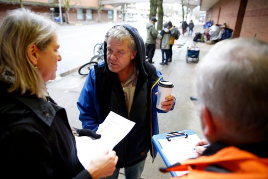 Kevin Parker, 58, is interviewed by volunteers Linda and Warren Bednarz during the Point-in-Time count in downtown Salem on Jan. 29, 2020. The annual survey of people experiencing homelessness has been expanded to last a week this year.