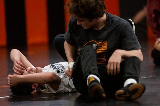 Sophomore Brayden Boyd pauses after drilling during wrestling practice at Sprague High School on Jan. 28, 2020.