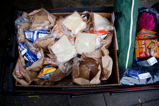 Sack lunches are ready to be given out during the Point-in-Time count in downtown Salem on Jan. 29, 2020. The annual survey of people experiencing homelessness has been expanded to last a week this year.