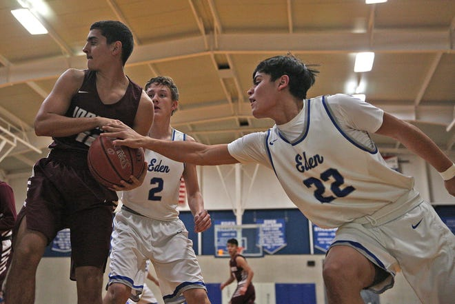 Julian Gamboa, right, and Kaleb Tinney, left center, put pressure on a Paint Rock player for Eden on Tuesday, Jan. 28, 2020.