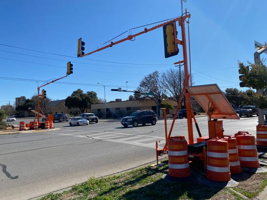 Portable traffic signals towered above the intersection of South Koenigheim and West Harris Avenue Wednesday, Jan. 29, 2020. The City of San Angelo installed the signals to help curb frequent crashes that occurred after a motorist damaged a traffic signal on Jan. 5.