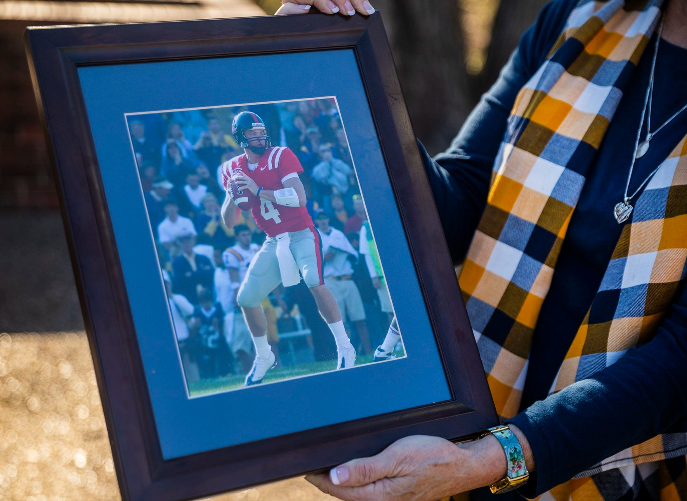 The family of Jevan Snead, a former UT and Ole Miss quarterback who died by suicide in September, share a photo of him during his college days.