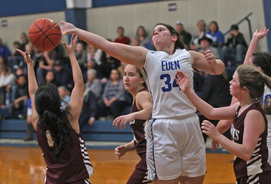 Gabby Flores, center, tries to block a shot for Eden during a game against Paint Rock on Tuesday, Jan. 28, 2020.